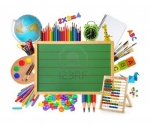 9857686-green-chalkboard-with-school-supplies